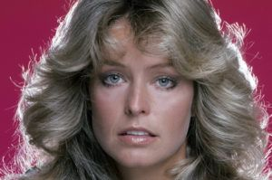"UNITED STATES - JUNE 15: CHARLIE'S ANGELS - gallery - Season One - 6/15/76 Farrah Fawcett-Majors (pictured), Jaclyn Smith and Kate Jackson played undercover detectives Jill Munroe, Kelly Garrett and Sabrina Duncan of the Charles Townsend Detective Agency. The trio, affectionately called ""Angels"" by their unseen-but-heard-over-speakerphone boss Charlie Townsend (the voice of John Forsythe) were assigned missions from Townsend and their office-based sidekick John Bosley (played by David Doyle). (Photo by ABC Photo Archives/ABC via Getty Images)"