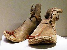 Oxhide_boots__Loulan,_Xinjiang__Early_Han_220_BCE_-_8_CE