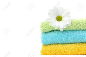7643189-Daisy-in-a-pile-of-colorful-clean-folded-towels-Stock-Photo-laundry-towel-white