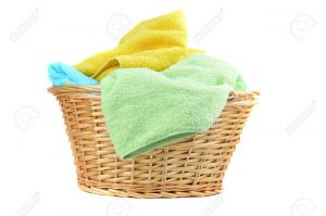 7643191-Towels-in-a-wicker-basket-isolated-on-white--Stock-Photo-laundry-basket